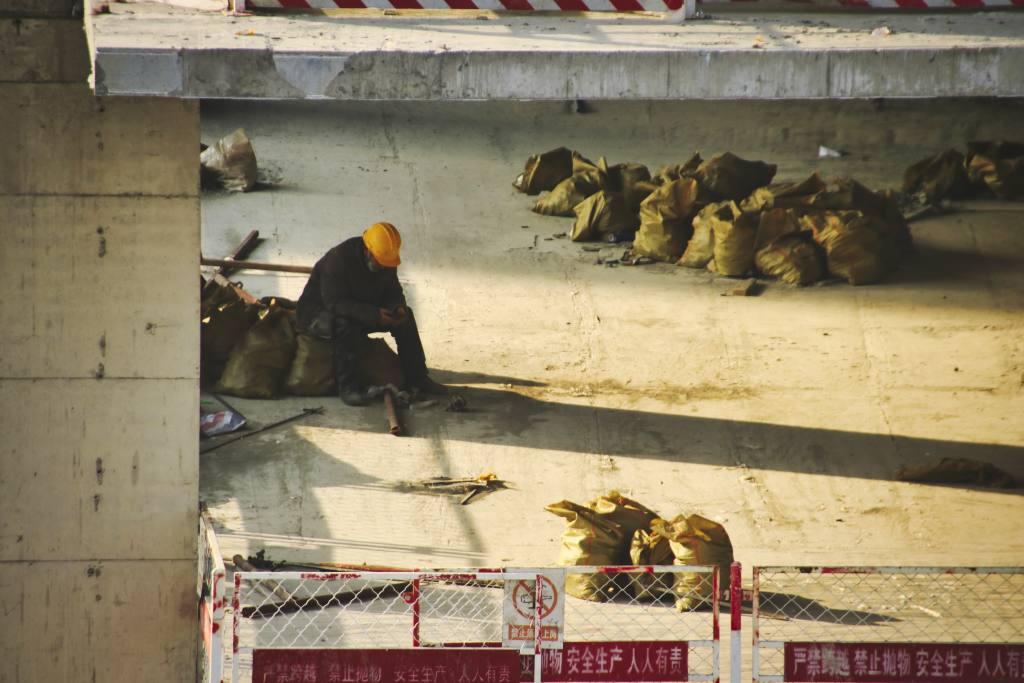 Arbeiter auf Baustelle in Peking